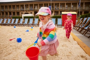 Young children play in sand