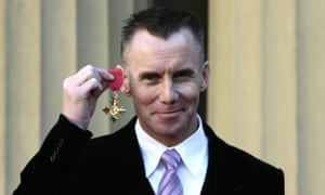 Gary Rhodes showing off his Order of the British Empire (OBE) awarded for services to the hospitality industry.
