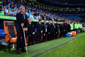 20 June 2019, Uruguay v Japan, Arena do Gremio, Porto Alegre. Uruguay manager Oscar Tabarez suffers from the rare Guillain-Barré syndrome and cannot walk unaided, stands for the national anthem in front of the chair he uses when pitch side.