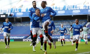Joe Aribo of Rangers celebrates with teammate James Tavernier after Rangers scored.