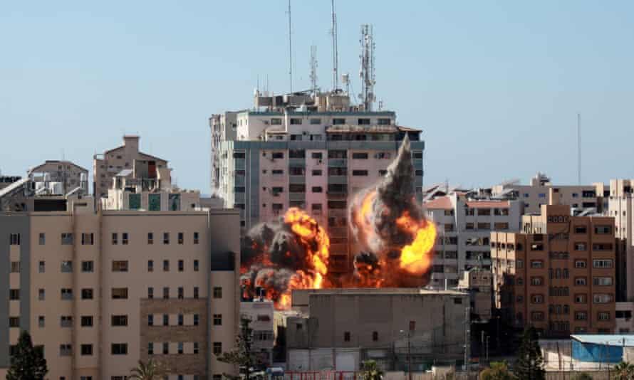An Israeli air strike hits al-Jalaa tower in Gaza on 15 May.