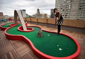 A Google employee demonstrates the use of the mini-putt green on the balcony at the new Google office in Toronto