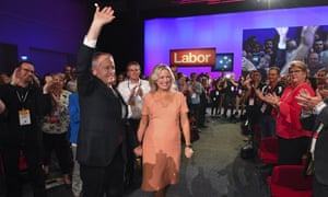 Bill Shorten and his wife, Chloe, wave at delegates as he arrives to deliver his speech at Labor party national conference.