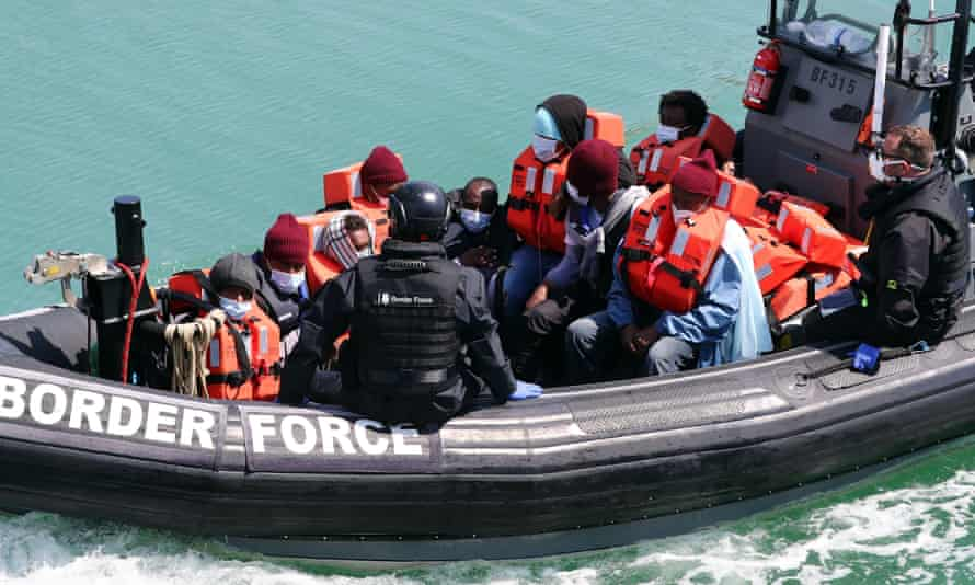 A group of people thought to be migrants are brought in to Dover off a small boat in the Channel last Sunday.