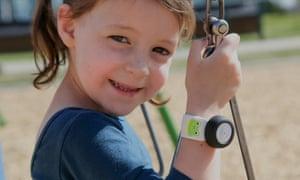 A child is seen wearing the mykidpod.