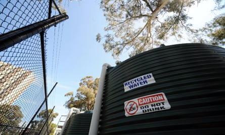 Rainwater tanks are used to harvest water from nearby council housing towers to irrigate a sports field in Fitzroy, Melbourne.