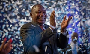 Cyril Ramaphosa applauds as confetti is launched at the end of the results ceremony in Pretoria.