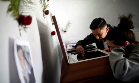 Relatives of Kimberly Fonseca who was shot during a protest mourn next to her coffin in Tegucigalpa.