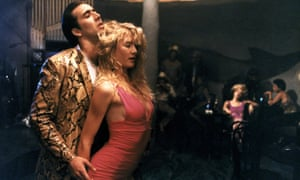 With Laura Dern in Wild at Heart, 1990.