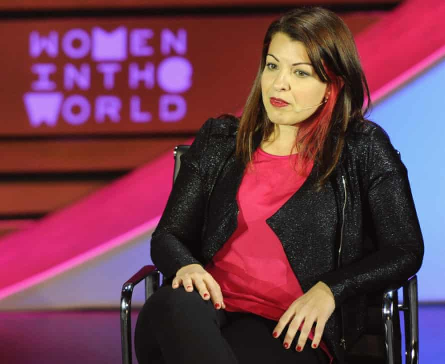 Anita Sarkeesian speaking on stage during the Women in the World Summit in 2015.