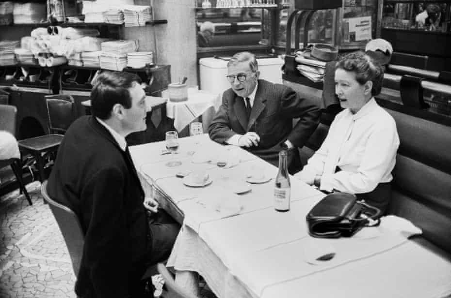 Sartre, De Beauvoir and director Claude Lanzmann dining in Paris, 1964.