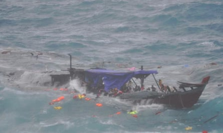 A boat smashes on the rocks off Christmas Island killing 48 people