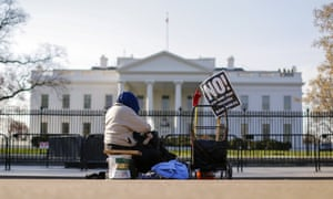 A lone protester in front of the White House in Washington DC Monday.