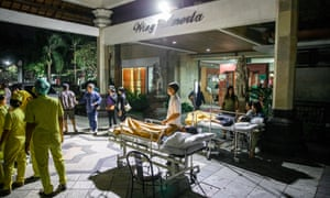 Patients are moved outside of the hospital building after the earthquake was felt in Denpasar, Bali