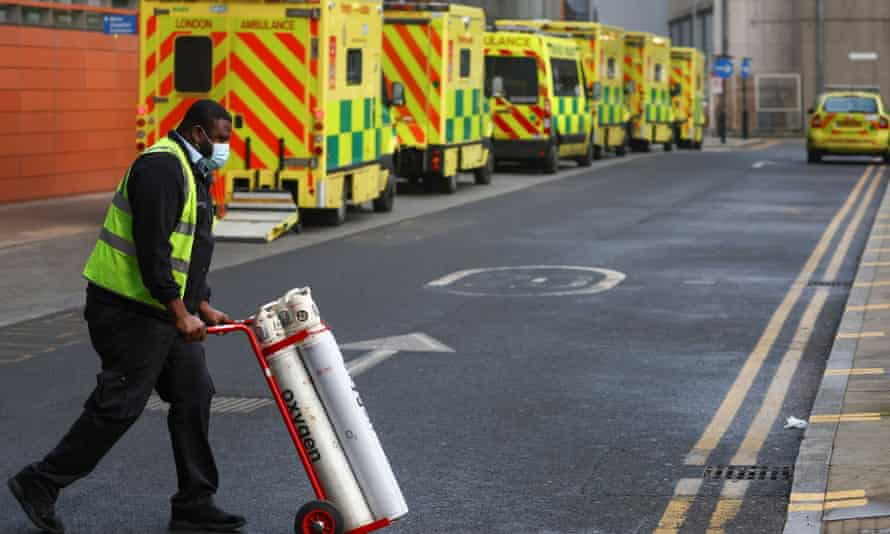 Ambulances queue at the Royal London Hospital last week, while some in the media said Covid would be gone by September.