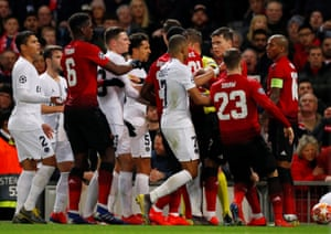 The players clash after Young's push on Di Maria.