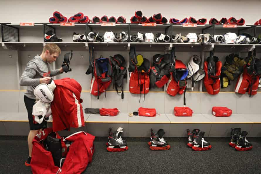 The Detroit Red Wings head equipment manager, Paul Boyer, packs up after his team's game against the Washington Capitals was postponed
