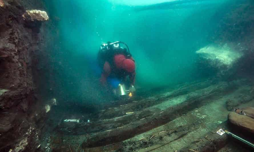 A diver explores the hull of a military vessel discovered in the sunken city of Thonis-Heracleion on Egypt's north coast
