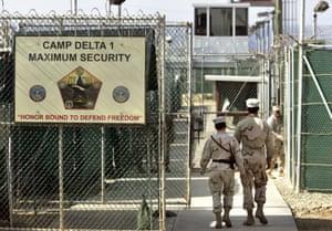 2006 file photo: US military guards walk within Camp Delta military-run prison, at the Guantanamo Bay US Naval Base, Cuba.