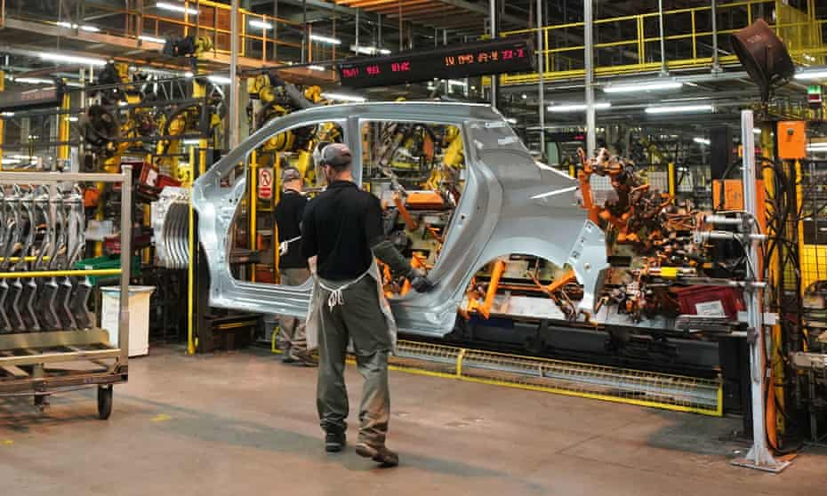 Workers on the production line at Nissan's factory in Sunderland.