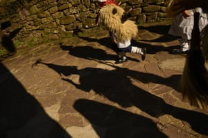Shadow of a group of Joaldunaks called Zanpantzar, reflect on the ground as they take part in the Carnival between the Pyrenees villages of Ituren and Zubieta