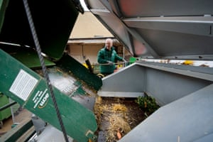 The grounds team empties animal waste to the disposal truck