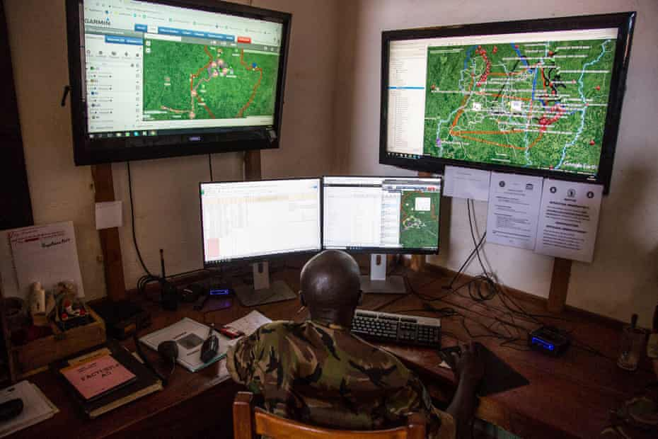 Davis, a Chinko employee, monitors various screens in the park's control room where software plots ranger movement, bushfires and other crucial information on a Google Earth map.