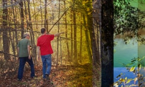 David Birmingham and Fred Isseks walk through the woods.