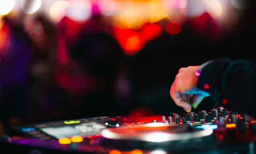 Close-Up Of Dj In Nightclub Music Background