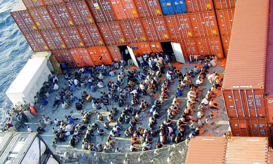 The 433 rescued asylum seekers onboard the Norwegian cargo ship MV Tampa on 27 August 2001 as it sat anchored off Christmas Island.