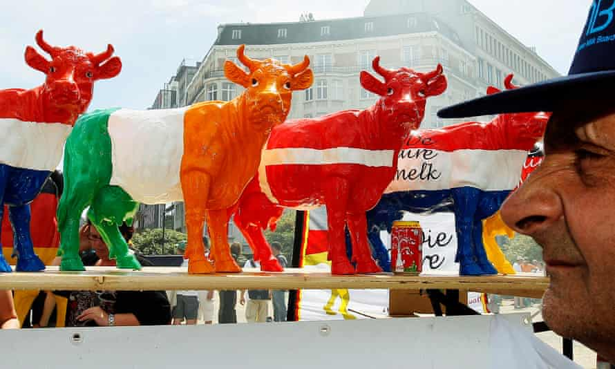 Models of cows at a farmers' protest against low milk prices, outside the European Council headquarters in Brussels