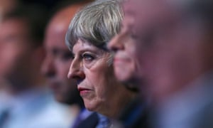 Theresa May listens to a speaker on the opening day of the Conservative party conference in Manchester on Sunday