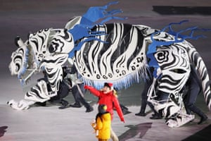A white tiger performs during the Opening Ceremony