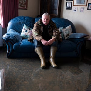 Andrew Benford in his flooded home in Fishlake Village.