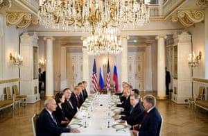 The presidents and others wait for a working lunch meeting at the palace