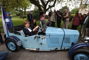 Nicola Sturgeon in the driving seat of a Midge car during a visit to Moffat on Friday