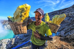 Category: Portrait. Title: Sulphur miner. A sulphur miner carries reed baskets in East Java,  Indonesia