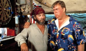 Rip Torn and John Candy in Summer Rental, 1985