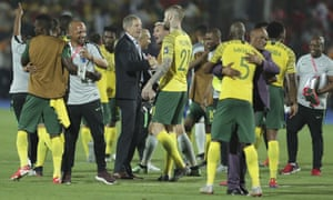 South Africa head coach Stuart Baxter, centre, celebrates with his players after the win over Egypt.