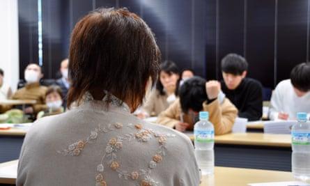 Junko Iizuka addresses a forum at the Tohoku Gakuin University in Sendai, Japan.