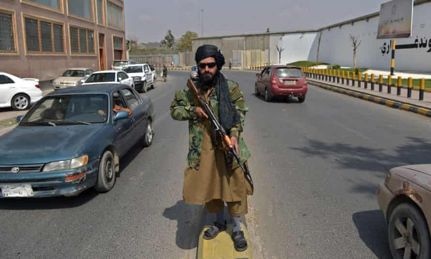 A Taliban fighter patrols a street near Zanbaq Square in Kabul on Thursday.