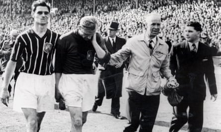Trautmann leaving the pitch after the final in 1956 with what he didn't know was a broken neck until several days later.