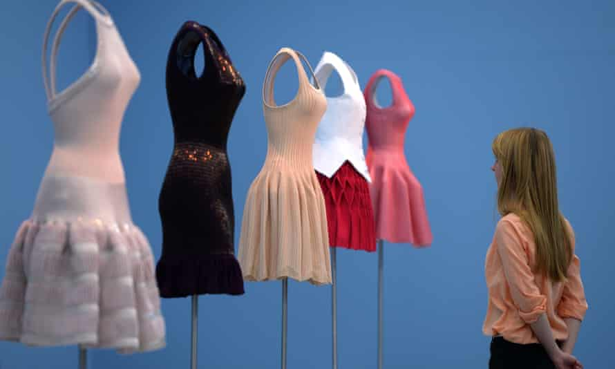 A visitor looks at clothes designed by Azzedine Alaïa at a museum in Germany.