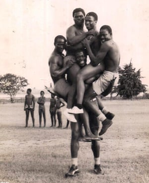 'Sunlight' Okiror is shown lifting several men up in an image chosen from his photo album by his son, Samuel.