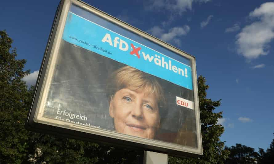 Rotating billboards show an election campaign poster of Angela Merkel intersecting with one of the right-wing, populist Alternative für Deutschland (AfD).