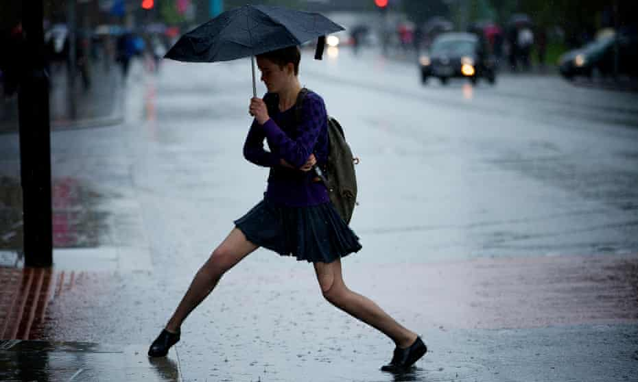 A University of Manchester student deals with heavy rain and high winds at the start of a new term.
