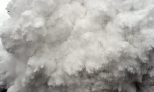 A cloud of snow and debris triggered by an earthquake flies towards Everest base camp.