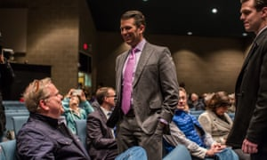 Donald Trump Jr greets Republican caucus-goers in precinct 317 ahead of the party caucus in West Des Moines, Iowa.