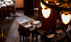 Interior of the dark-wood-design restaurant Parrilla Don Julio, Buenos Aires, Argentina.