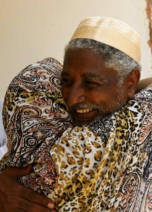 Mudawi Ibrahim Adam celebrates his release at his home in Omdurman, Khartoum